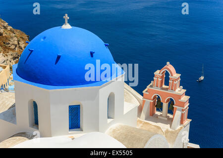 Traditional Greek Cyclades architecture style in Oia, a small town at the northern tip on Santorini, Greece - Stock Photo