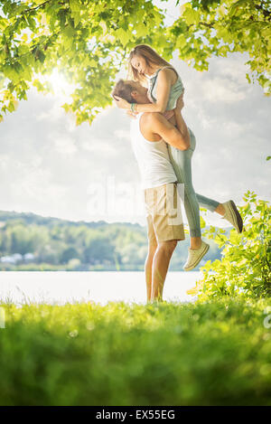 Couple in love on the lake, hug - Stock Photo