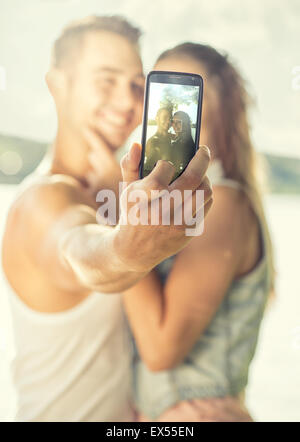 Couple in love on the lake, close-up, selfie