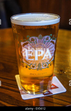 A pint of Marston's EPA real ale on a beermat pub table drinks glasses - Stock Photo