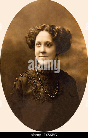 Late Victorian portrait of elegant woman in embroidered black dress and jet necklace, with prominent jawline - Stock Photo