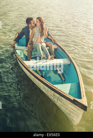 Couple in love on the boat - kissing - Stock Photo
