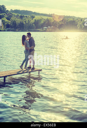 Couple embrace on the pier - Stock Photo