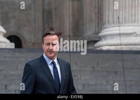 London, UK. 7th July, 2015. 10th Anniversary of London Bombings, UK Prime Minister David Cameron leaves St Paul's - Stock Photo