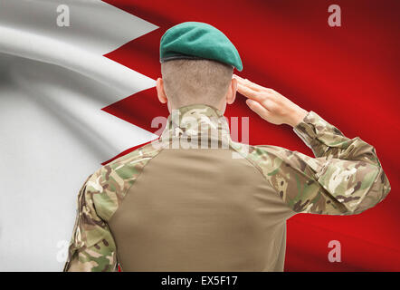 Soldier in hat facing national flag series - Bahrain - Stock Photo