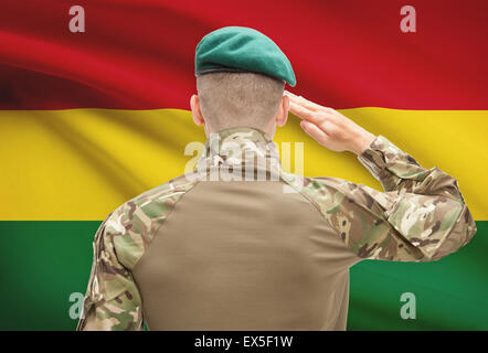 Soldier in hat facing national flag series - Bolivia - Stock Photo
