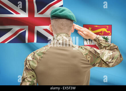 Soldier in hat facing national flag series - Fiji - Stock Photo