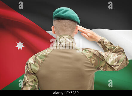 Soldier in hat facing national flag series - Jordan - Stock Photo