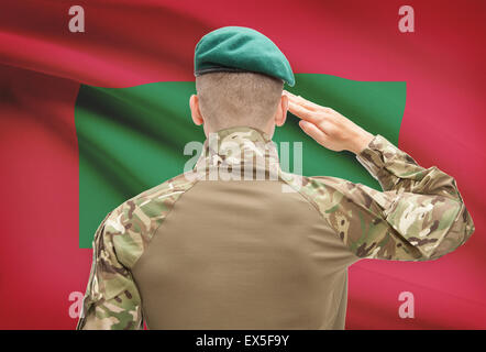 Soldier in hat facing national flag series - Maldives - Stock Photo
