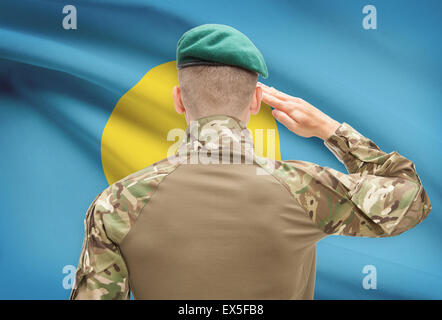 Soldier in hat facing national flag series - Palau - Stock Photo