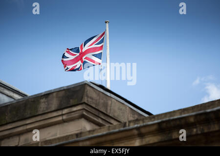 Union jack flag billowing against a dramatic sky - Stock Photo