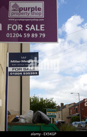 Multiple houses for sale in a row in Blackrod - Stock Photo