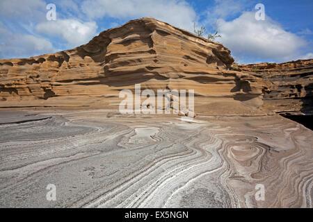 Pancake layered sandstone rock formations along the arid rocky coast on the island São Nicolau, Cape Verde / Cabo - Stock Photo