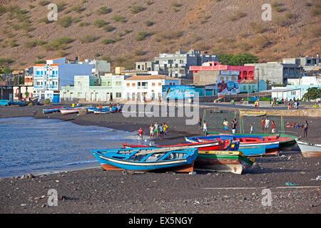Colourful wooden fishing boats on the black sand beach of Tarrafal de São Nicolau on the island São Nicolau, Cape - Stock Photo