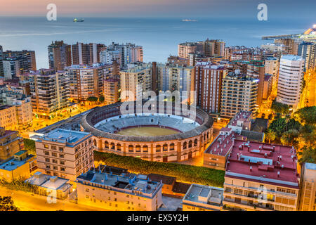 Malaga, Spain cityscape and bullring at dawn. - Stock Photo