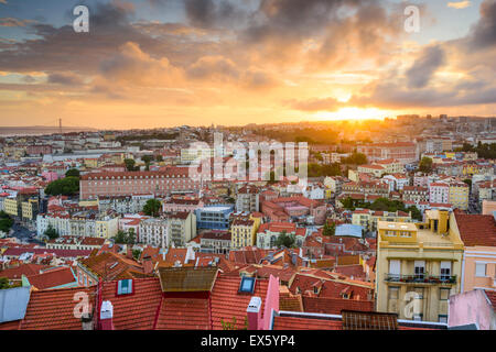 Lisbon, Portugal old town skyline at sunset. - Stock Photo