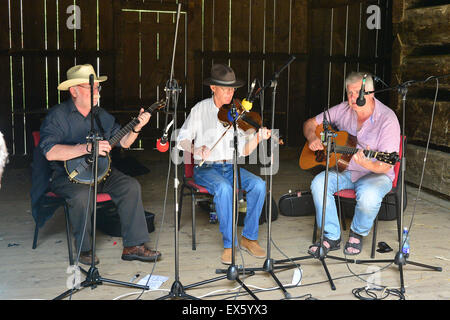 Irish old time string band OXO playing in a barn. From left, Bill Whelan, Ron Kane, Ben Keogh - Stock Photo