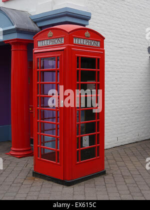An old fashioned red telephone box - Stock Photo
