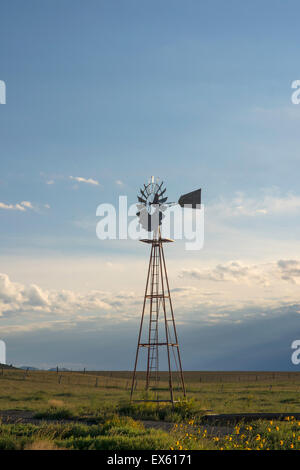 Windmill on a farm or ranch in rural Colorado - Stock Photo