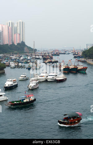 Hong Kong, Hong Kong SAR -November 19, 2014: Fishing boats in Aberdeen harbour in Hong Kong. - Stock Photo