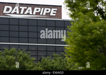 A logo sign outside of an office building occupied by Datapipe in Reston, Virginia. - Stock Photo
