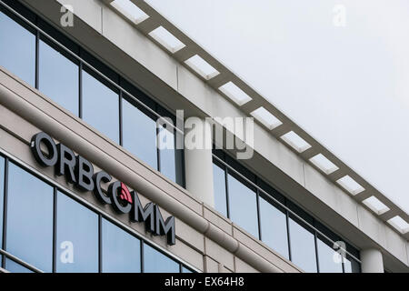 A logo sign outside of an office building occupied by ORBCOMM, Inc., in Sterling, Virginia. - Stock Photo
