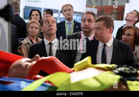 Yekaterinburg, Russia. 8th July, 2015. Russia's Prime Minister Dmitry Medvedev (L) visits the Innoprom 2015 International - Stock Photo