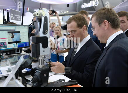 Yekaterinburg, Russia. 8th July, 2015. Russia's Prime Minister Dmitry Medvedev (2nd R) visits the Innoprom 2015 - Stock Photo