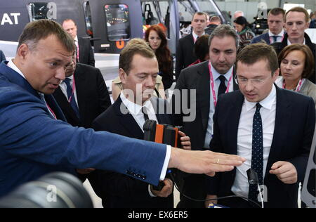 Yekaterinburg, Russia. 8th July, 2015. Russia's Prime Minister Dmitry Medvedev (C) visits the Innoprom 2015 International - Stock Photo