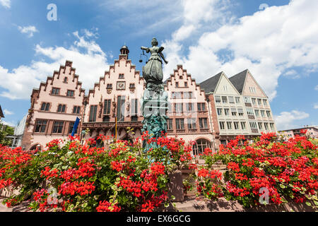 Lady Justice statue with fountain and flowers at the Roemberberg in Frankfurt Main, Germany - Stock Photo