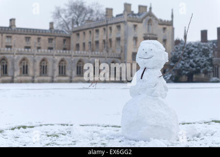 Snowman on lawn infront of St John College Cambridge University - Stock Photo