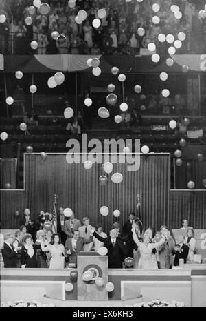 Photograph of President Gerald Ford, First Lady Betty Ford, Senator Bob Dole and Elizabeth Dole celebrate winning the nomination amidst floating balloons at the Republican National Convention. Photographed by John T. Bledsoe. Dated 1976