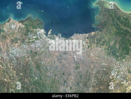 Colour satellite image of Jakarta, Indonesia. Image taken on April 22, 2014 with Landsat 8 data. - Stock Photo