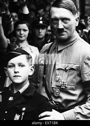 Adolf Hitler 1889-1945, German Nazi leader, seen standing with a young Hitler Youth Member 1934 - Stock Photo