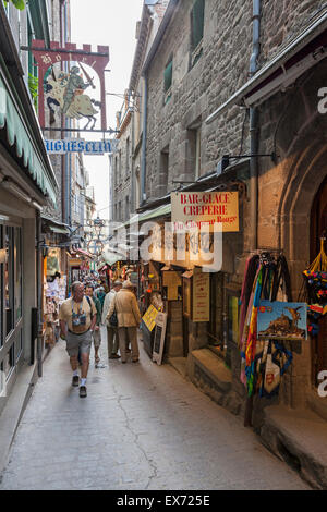 Tourists thronging in the narrow main street of Mont St Michel, Normandy, France - Stock Photo