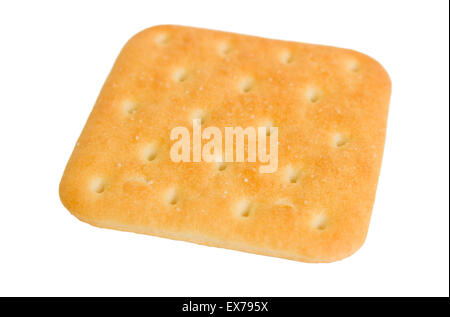 Square cracker biscuits with salt isolated on a white background. - Stock Photo