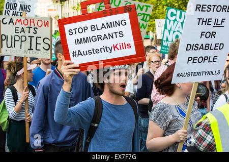 Hundreds of anti-austerity protesters responded to the Conservative government budget by holding a die-in protest - Stock Photo