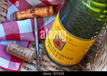 'Hugel' Gewurztraminer white wine bottle cork and corkscrew in picnic basket in sunny alfresco situation Riquewihr - Stock Photo