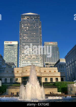 Late afternoon sun illuminates the towers in Cabot Square Canada One HSBC and CiTi Banks Canary Wharf London financial - Stock Photo