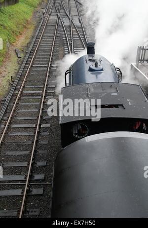Steam Train departing Haverthwaite station on the Lakeside & Haverthwaite Steam Railway, Cumbria - Stock Photo