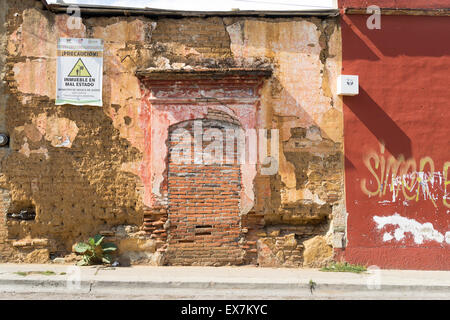 Interesting textures of a crumbling brick and plaster wall in Oaxaca Mexico - Stock Photo