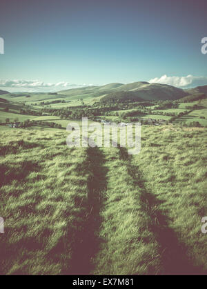 Winding Path Or Track High In The Hills Of A Rolling Rural Landscape - Stock Photo