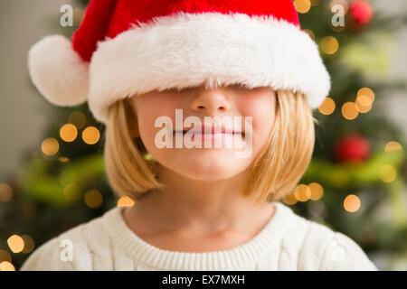 Girl (6-7) wearing Santa hat - Stock Photo