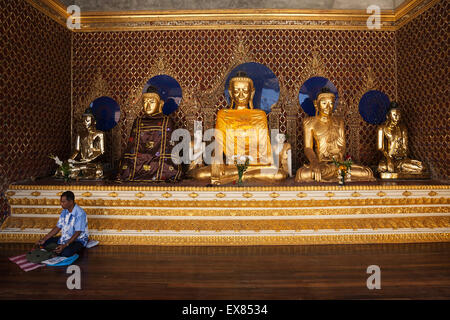 Buddha statues in the Shwedagon Pagoda, Yangon, Myanmar - Stock Photo