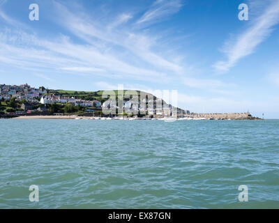 View of New Quay harbour, Ceredigion, Wales, from the sea on a sunny summer's day - Stock Photo