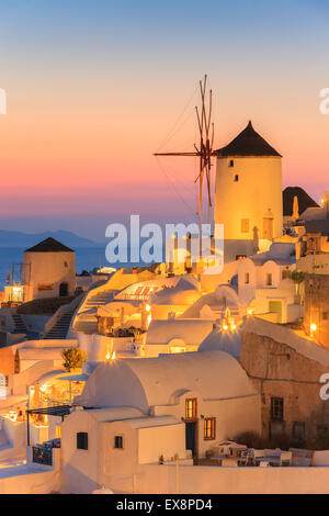 The town of Oia during sunset on Santorini, one of the Cyclades islands in Aegean Sea, Greece. - Stock Photo