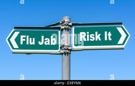 Flu Jab or Risk It sign. Flu inoculation. Influenza prevention injection. Flu vaccine. Flu shot. - Stock Photo