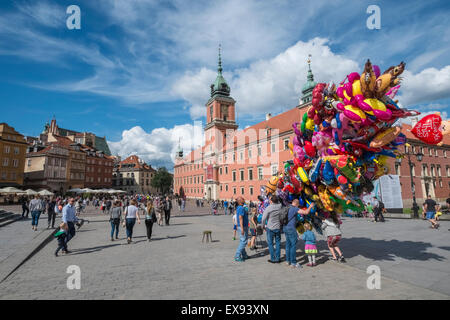 Balloon seller on Castle Square on a bright summers day, with Royal Castle building in background, Old Town, Warsaw, - Stock Photo