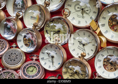 Collection of old pocket watches at a flea market (Cat Street Market on Upper Lascar Row in Hong Kong, China) - Stock Photo