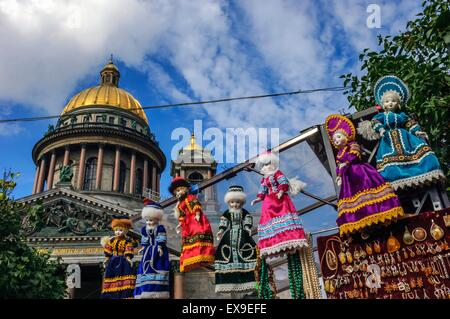 Souvenir market stall selling Russian dolls in front of St Isaac's Cathedral. St Petersburg. Russia - Stock Photo